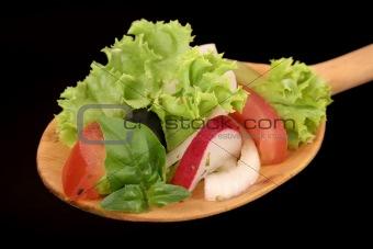 wooden spoon with garden salad