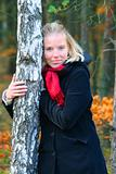 blonde in an autumn wood