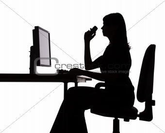 silhouette of woman working computer (phone)