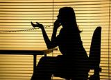silhouette of woman on the phone