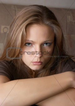 Offennded look of beautiful girl. Soft portrait.