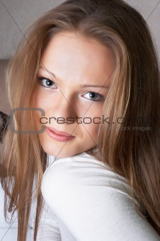 Modest smile on face of beautiful girl. Soft portrait.