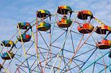 silhouette of colorful joy wheel in amusement park