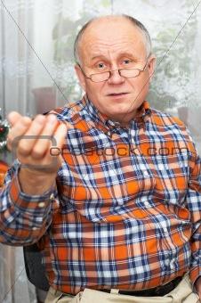Casual bald senior man emotional portrait series.