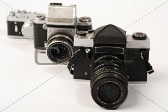 Three photo cameras