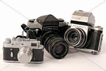 Three photo cameras