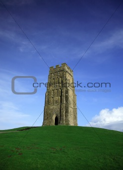 Glastonbury Tor against a vivid blue sky