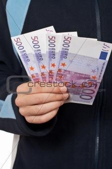 Teenager showing a fan money