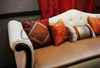 Modern sofa with colorful cushions
