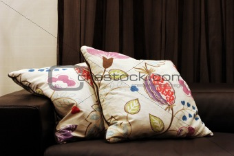 Modern sofa with patterned cushions