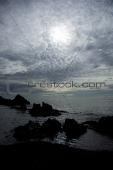 Rocks silhouetted on Dritvik beach
