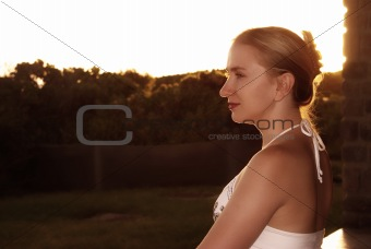 Blonde woman sitting outside