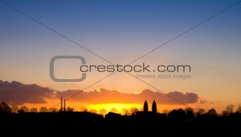 village silhouette at sunset