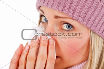 blonde girl blowing nose (isolated)