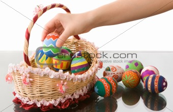 Arranging easter eggs in beautiful basket