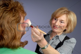 attractive older lady make up artist