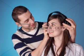 attractive young couple listen to music