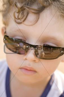 Boy in sun glasses close up