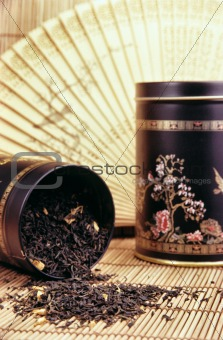 Black tea spilling out - still life