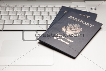 Abstract of Two Passports on a Laptop Computer Keyboard.
