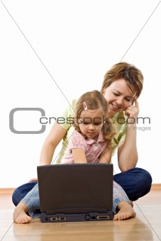 Little girl learning to use the computer