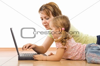 Little girl and woman with laptop