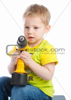 Little boy with screwdriver