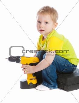 Boy holding electric screwdriver
