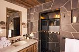 Luxurious Rustic Bathroom with Mining Lamps in Spa Setting.