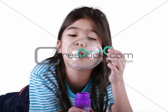 Small girl blowing bubbles