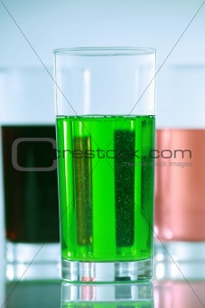 Three glasses with colorful drinks
