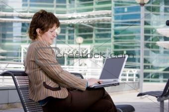 Beautiful brunette woman on computer