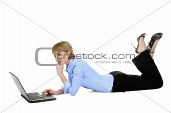 Beautiful businesswoman with laptop lying on the floor