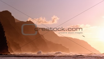 Sunset off the Na Pali coastline on Kauai with a stormy sea