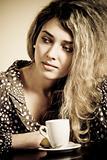 Portrait of beautiful sad woman in cafe