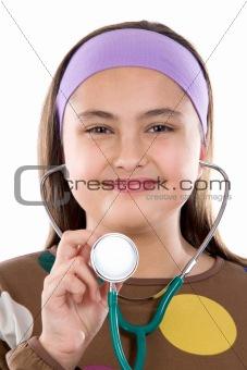 Little girl doctor making examining