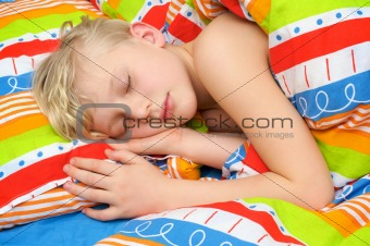 Sleeping child on the bed