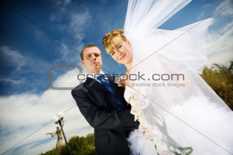 bride with flying veil and groom