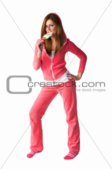 Young beautiful woman in the pink sportswear