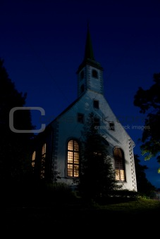 Small white church in evening
