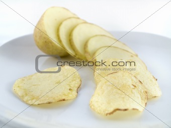 Potato sliced into chips crisps
