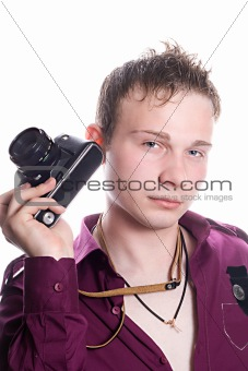 The young man with old camera. Isolated on white