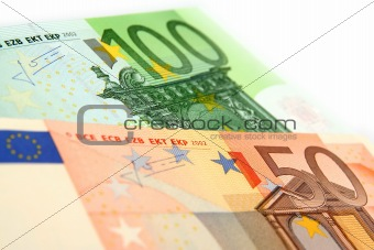 a few euro bills on a white background