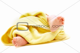 tiny baby's feet in towel over white
