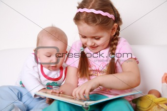 Adorable kids reading and playing