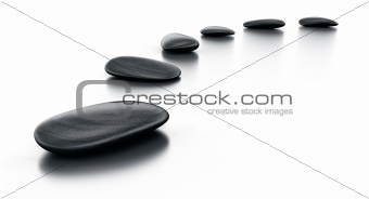 Black stones on reflective floor