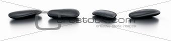 Black stones on reflective floor