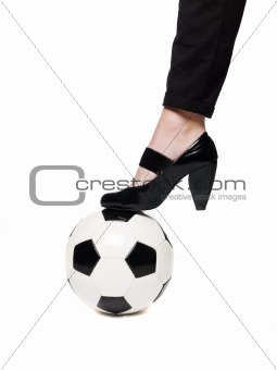 Fotball and a lady`s slipper