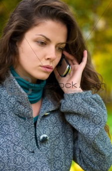 Beautiful young woman talking on cell phone