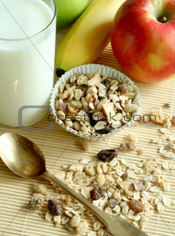 Breakfast, muesli apple and glass of milk
